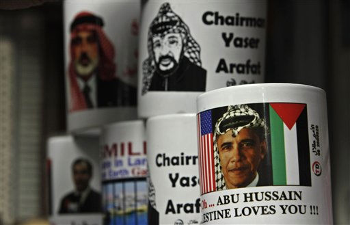 Mugs with pictures of U.S. President Barack Obama wearing a keffiyeh, right, late Palestinian leader Yasser Arafat, top right, and Gazan Hamas Prime Minister Ismail Haniyeh, top left, are displayed in a souvenir shop in Gaza City, Tuesday, Nov. 9, 2010. Palestinians will mark the sixth anniversary of Arafat&#39;s death on Nov. 11. Full text on mug with Obama&#39;s picture reads &#34;Oh, Abu Hussain, Palestine loves you.&#34; &#40;AP Photo&#47;Adel Hana&#41; <span class=meta>(AP Photo&#47; Adel Hana)</span>