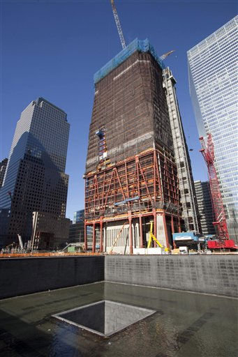 One of two National September 11 Memorial pools is shown Tuesday, Nov. 9, 2010 at the World Trade Center site in New York. The two memorial pools, which are scheduled to be open to the public in September 2011, reflect the location of the original twin towers. The Freedom Tower, One World Trade Center, is top center. &#40;AP Photo&#47;Mark Lennihan&#41; <span class=meta>(AP Photo&#47; Mark Lennihan)</span>