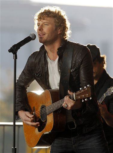 "<div class=""meta image-caption""><div class=""origin-logo origin-image ""><span></span></div><span class=""caption-text"">Country singer Dierks Bentley performs on an outdoor stage in the early morning on Wednesday, Nov. 10, 2010, in Nashville, Tenn., in conjunction with the CMA Awards show that will be held Wednesday night. (AP Photo/Mark Humphrey) (AP Photo/ Mark Humphrey)</span></div>"