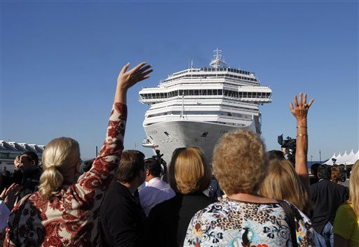Spectators wave as the disabled Carnival Splendor cruise ship approaches the dock in San Diego on Thursday, Nov. 11, 2010. &#40;AP Photo&#47;Jae C. Hong&#41; <span class=meta>(AP Photo&#47; Jae C. Hong)</span>