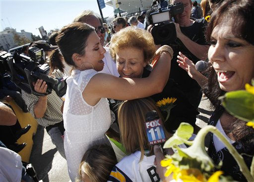 Annette Turner, center, gets a hug from her granddaughter Annette Rasmussen, after Turner got off the disabled Carnival Splendor cruise ship in San Diego, Calif., Thursday, Nov. 11, 2010. &#40;AP Photo&#47;Jae C. Hong&#41; <span class=meta>(AP Photo&#47; Jae C. Hong)</span>