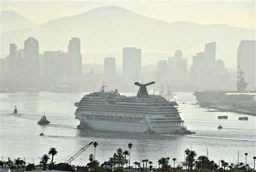 Tugboats tow the disabled cruise ship Carnival Splendor into San Diego Bay Thursday, Nov. 11, 2010.  The ship, which lost power four days ago with nearly 4,500 passengers and crew aboard, was towed from the waters off the coast of Mexico. &#40;AP Photo&#47;Denis Poroy&#41; <span class=meta>(AP Photo&#47; Denis Poroy)</span>
