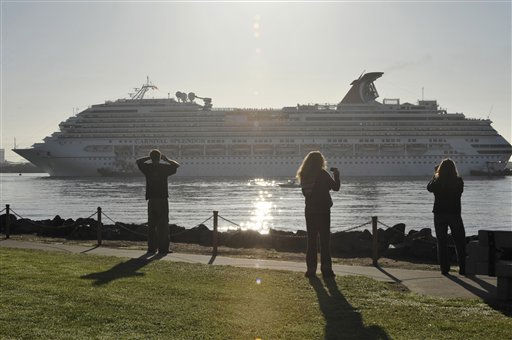 Spectators look on from shore as tugboats bring the disabled cruise ship Carnival Splendor into San Diego Bay on Thursday, Nov. 11, 2010. The ship, which lost power four days ago with nearly 4,500 passengers and crew aboard, was towed from the waters off the coast of Mexico. &#40;AP Photo&#47;Denis Poroy&#41; <span class=meta>(AP Photo&#47; Denis Poroy)</span>