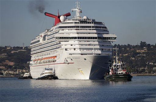 Carnival Splendor cruise ship is towed into San Diego Bay where it docked and most of the 4500 people aboard will disembark Thursday Nov. 11, 2010. &#40;AP Photo&#47;Lenny Ignelzi&#41; <span class=meta>(AP Photo&#47; Lenny Ignelzi)</span>