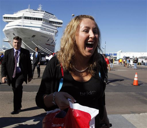 Sabrina Klinge, right, a passenger who was onboard the Carnival Splendor cruise ship for her honeymoon, leaves the cruise ship terminal in San Diego, Calif., Thursday, Nov. 11, 2010. &#40;AP Photo&#47;Jae C. Hong&#41; <span class=meta>(AP Photo&#47; Jae C. Hong)</span>