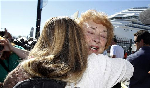 Jeanne Ralston, facing camera, gets a hug from her daughter Cindi Wolfe after Ralston got off the disabled Carnival Splendor cruise ship in San Diego, Calif., Thursday, Nov. 11, 2010. &#40;AP Photo&#47;Jae C. Hong&#41; <span class=meta>(AP Photo&#47; Jae C. Hong)</span>