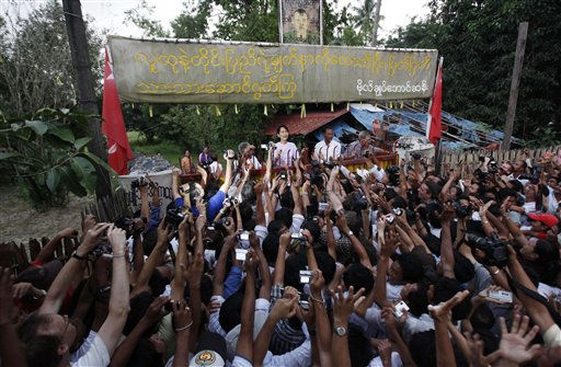 "<div class=""meta ""><span class=""caption-text "">Myanmar's pro-democracy leader Aung San Suu Kyi addresses her supporters from her house compound after her release from house arrest in Yangon, Myanmar, Saturday, Nov. 13, 2010. (AP Photo) (AP Photo/ GA NT**TOK** HY**TOK**)</span></div>"