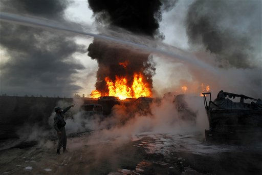 "<div class=""meta ""><span class=""caption-text "">An Afghan police officer points to the site of fire after a convoy of NATO fuel tankers was attacked by militants in Behsod district of Nangarhar province, east of Kabul, Afghanistan, Sunday, Nov 14, 2010. An Afghan Officials say insurgents set fire to a convoy of NATO fuel tankers in eastern Afghanistan, while a bomb blast in the south killed a NATO service member and other civilians. (AP Photo/Rahmat Gul) (AP Photo/ Rahmat Gul)</span></div>"