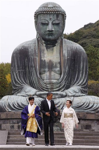 President Barack Obama visits the Great Buddha of Kamakura with Michiko Sato, temple director, and Takao Sato, the 15th chief monk of the temple, at Kotoku-in Temple in Kamakura, Japan,  Sunday, Nov. 14, 2010. &#40;AP Photo&#47;Charles Dharapak&#41; <span class=meta>(AP Photo&#47; Charles Dharapak)</span>