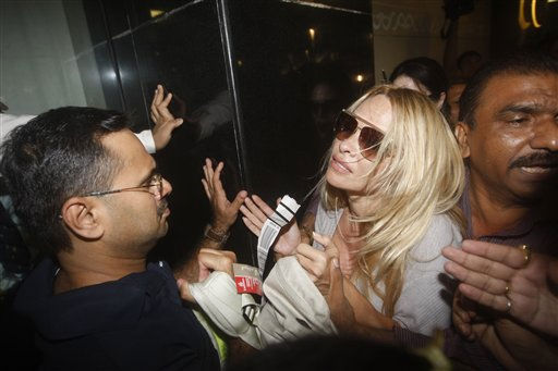 Security guards and Airport officials try to protect U.S. actress Pamela Anderson from media  after she arrived at the Chhatrapati Shivaji International Airport in Mumbai, India, Monday, Nov 15, 2010. Anderson is in India to take part in a TV reality show &#39;Big Boss - Season 4&#39; which is hosted by Bollywood actor Salman Khan .&#40;AP Photo&#47;Rafiq Maqbool&#41; <span class=meta>(AP Photo&#47; Rafiq Maqbool)</span>