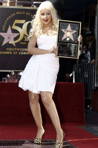 """<div class=""""meta image-caption""""><div class=""""origin-logo origin-image """"><span></span></div><span class=""""caption-text"""">Singer and actress Christina Aguilera poses after she received a star on the Hollywood Walk of Fame in Los Angeles, Monday, Nov. 15, 2010.  (AP Photo/Matt Sayles) (AP Photo/ Matt Sayles)</span></div>"""