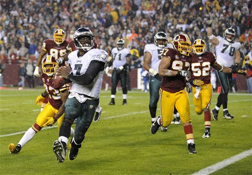 Philadelphia Eagles quarterback Michael Vick rushes for a touchdown against the Washington Redskins during the first half of an NFL football game, Monday, Nov. 15, 2010, in Landover, Md. &#40;AP Photo&#47;Nick Wass&#41; <span class=meta>(AP Photo&#47; Nick Wass)</span>