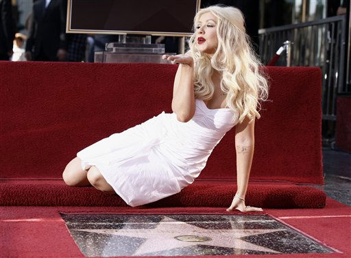 "<div class=""meta ""><span class=""caption-text "">Singer and actress Christina Aguilera poses after she received a star on the Hollywood Walk of Fame in Los Angeles, Monday, Nov. 15, 2010.  (AP Photo/Matt Sayles) (AP Photo/ Matt Sayles)</span></div>"