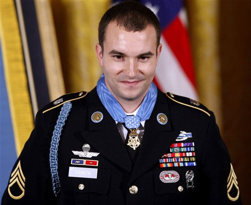 Army Staff Sgt. Salvatore Giunta is pictured after he was awarded the Medal of Honor by President Barack Obama during a ceremony in the East Room of the White House in Washington, Tuesday, Nov. 16, 2010. Giunta, from Hiawatha, Iowa, is the first living veteran of the wars in Iraq and Afghanistan to receive the award. &#40;AP Photo&#47;Charles Dharapak&#41; <span class=meta>(AP Photo&#47; Charles Dharapak)</span>