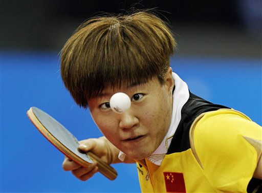 China&#39;s Yan Guo serves to Singapore&#39;s Tian Wei Feng during the women&#39;s team final of the Table Tennis event at the 16th Asian Games in Guangzhou, China, Tuesday, Nov. 16, 2010. &#40;AP Photo&#47;Gurinder Osan&#41; <span class=meta>(AP Photo&#47; Gurinder Osan)</span>