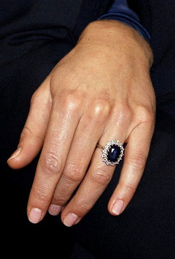 "<div class=""meta image-caption""><div class=""origin-logo origin-image ""><span></span></div><span class=""caption-text"">Kate Middleton wears the engagement ring of Diana, Princess of Wales, as she poses for the media with Britain's Prince William  following the announcement of their engagement, at St. James's Palace in London, Tuesday Nov. 16, 2010. The couple are to wed in 2011. (AP Photo/Kirsty Wigglesworth) (AP Photo/ Kirsty Wigglesworth)</span></div>"