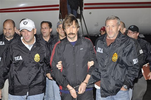 This image provided by the Drug Enforcement Administration shows Russian arms trafficking suspect Viktor Bout, center, in U.S. custody after being flown from Bangkok to New York on Tuesday Nov. 16, 2010 in a chartered U.S. plane, extradited in manacles to face terrorism charges despite a final outraged push by Russian diplomats to persuade Thailand to release him. &#40;AP Photo&#47;Drug Enforcement Administration&#41; <span class=meta>(AP Photo&#47; Anonymous)</span>