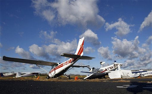 Small aircraft damaged by high winds sit on the tarmac Wednesday Nov. 17, 2010, at Trenton Mercer Airport in Ewing Township, N.J. &#40;AP Photo&#47;Mel Evans&#41; <span class=meta>(AP Photo&#47; Mel Evans)</span>