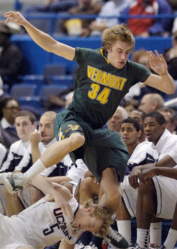 Connecticut&#39;s Niels Giffey, bottom, gets tangled with Vermont&#39;s Matt Glass during the first half of an NCAA college basketball game in Hartford, Conn., on Wednesday, Nov. 17, 2010. &#40;AP Photo&#47;Fred Beckham&#41; <span class=meta>(AP Photo&#47; Fred Beckham)</span>