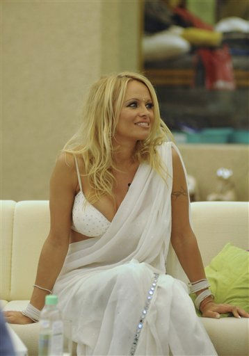 In this Tuesday, Nov. 16, 2010 photo provided on Tuesday by Public Relations firm Genesis Burson-Marsteller, former &#34;Baywatch&#34; star Pamela Anderson dressed in a white saree sits at the Indian reality television show &#34;Big Boss&#34; in Mumbai, India. &#40;AP Photo&#47;Genesis Burson-Marsteller&#41;  <span class=meta>(AP Photo&#47; Anonymous)</span>