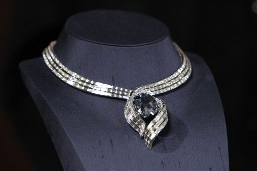 The Hope Diamond is seen in its unveiling of its new temporary setting, &#34;Embracing Hope,&#34; Thursday, Nov. 18, 2010, at the Smithsonian&#39;s National Museum of Natural History in Washington. The temporary setting is platinum with 340 baguette diamonds and took more than eight months to create. &#40;AP Photo&#47;Ann Heisenfelt&#41; <span class=meta>(AP Photo&#47; Ann Heisenfelt)</span>