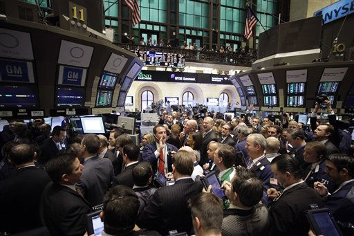 Traders gather around the GM post at the New York Stock Exchange during the GM initial public offering, Thursday, Nov. 18, 2010, in New York. &#40;AP Photo&#47;Mark Lennihan&#41; <span class=meta>(AP Photo&#47; Mark Lennihan)</span>