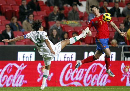 Portugal&#39;s Bruno Alves, left, goes  for the ball with Spain&#39;s Fernando Torres during their friendly soccer match Wednesday Nov. 17 2010, at Luz stadium in Lisbon. &#40;AP Photo&#47;Armando Franca&#41; <span class=meta>(AP Photo&#47; Armando Franca)</span>