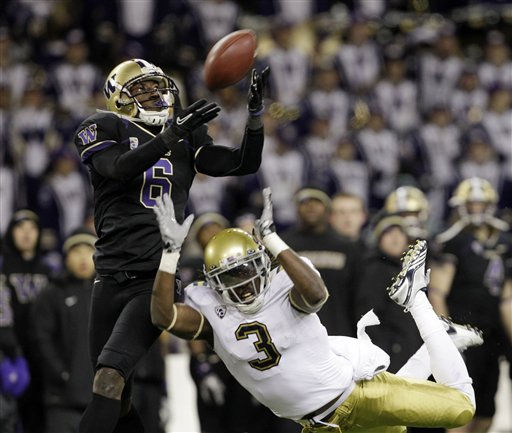 Washington&#39;s Desmond Trufant, left, deflects, and nearly intercepts, a pass intended for UCLA&#39;s Josh Smith in the second half of their NCAA college football game, Thursday, Nov. 18, 2010, in Seattle. Washington won 24-7. &#40;AP Photo&#47;Elaine Thompson&#41; <span class=meta>(AP Photo&#47; Elaine Thompson)</span>