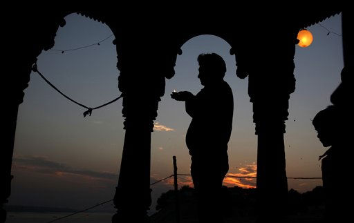 A Hindu devotee is silhouetted as he performs rituals during Karthik Purnima in Allahabad, India, Sunday, Nov. 21, 2010. Karthik Purnima is a Hindu holy day celebrated on the full moon day or the fifteenth lunar day of Karthik &#40;November-December&#41; month of the Hindu calendar. &#40;AP Photo&#47;Rajesh Kumar Singh&#41; <span class=meta>(AP Photo&#47; Rajesh Kumar Singh)</span>