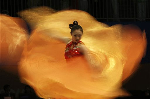 Dancers perform before the victory ceremony of the fencing event at the 16th Asian Games in Guangzhou, China, Sunday, Nov. 21, 2010. &#40;AP Photo&#47;Gurinder Osan&#41; <span class=meta>(AP Photo&#47; Gurinder Osan)</span>