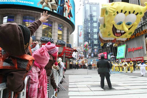 Yuri Van Singh, 6, from Maryland, left, waves as the SpongeBob SquarePants float approaches by during the Macy&#39;s Thanksgiving Day Parade Thursday, Nov. 25, 2010 in New York. &#40;AP Photo&#47;Tina Fineberg&#41; <span class=meta>(AP Photo&#47; Tina Fineberg)</span>