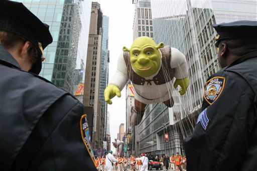 "<div class=""meta ""><span class=""caption-text "">Members of the New York Police Department stand by as the Shrek balloon makes it's way across 42nd Street during the Macy's Thanksgiving Day Parade on Thursday, Nov. 25, 2010 in New York. (AP Photo/Tina Fineberg) (AP Photo/ Tina Fineberg)</span></div>"