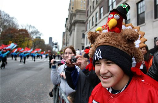 "<div class=""meta ""><span class=""caption-text "">Anthony D'Attoma, 14,  of Deer Park, N.Y. wears a turkey hat during the Macy's Thanksgiving Day Parade in New York Thursday, Nov. 25, 2010.  (AP Photo/Craig Ruttle) (AP Photo/ Craig Ruttle)</span></div>"