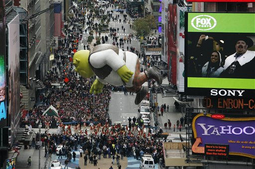 The Shrek balloon floats through Times Square during the Macy's Thanksgiving Day parade in New York, Thursday, Nov. 25, 2010. (AP Photo/Jeff Christensen)