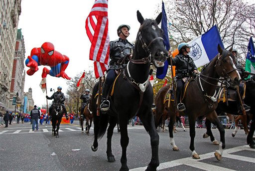 The New York City police department leads the Spider Man balloon during the Macy's Thanksgiving Day Parade in New York Thursday, Nov. 25, 2010. (AP Photo/Craig Ruttle)