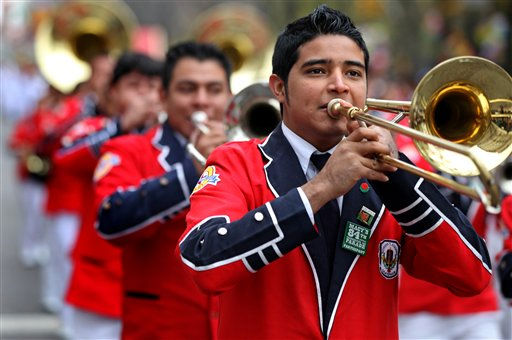 A member of Banda Musical Latina Pedro Molina of Guatemala performs during the Macy's Thanksgiving Day Parade in New York Thursday, Nov. 25, 2010. (AP Photo/Craig Ruttle)