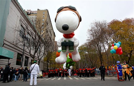 The balloon Snoopy floats above the street before the start of the Macy&#39;s Thanksgiving Day Parade in New York Thursday, Nov. 25, 2010.  &#40;AP Photo&#47;Craig Ruttle&#41; <span class=meta>(AP Photo&#47; Craig Ruttle)</span>