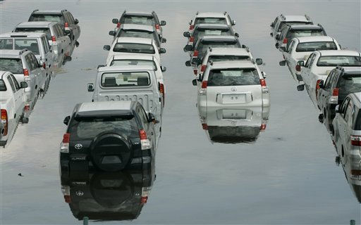 "<div class=""meta ""><span class=""caption-text "">Cars are partially covered by water at the flooded parking lot of a car importer in Palmira, southern Colombia, Tuesday, Nov. 30, 2010.  According to meteorologists the ""La Nina"" climatic phenomenon is causing an exceptionally wet rainy season that has caused floods and landslides, killing over 130 people throughout Colombia. (AP Photo/Christian Escobar Mora) (AP Photo/ Christian Escobar Mora)</span></div>"