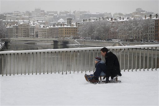 "<div class=""meta ""><span class=""caption-text "">A man and his children enjoy the snow on a sled in Lyon, central France, Wednesday, Dec. 1, 2010. (AP Photo/Laurent Cipriani) (AP Photo/ Laurent Cipriani)</span></div>"