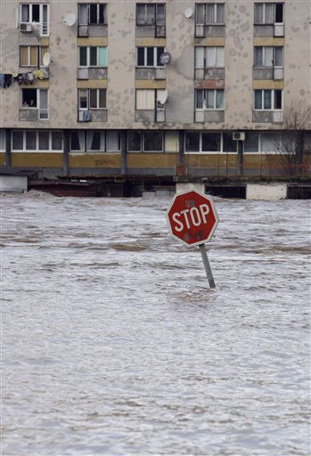 "<div class=""meta ""><span class=""caption-text "">Traffic sign is seen on a road flooded with water from the river Drina, in Gorazde, Bosnia, Thursday, Dec. 2, 2010. Authorities have declared a state of emergency and are evacuating people after heavy rainfall caused floods in several areas of Bosnia. (AP Photo/Amel Emric) (AP Photo/ Amel Emric)</span></div>"