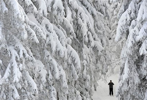 "<div class=""meta ""><span class=""caption-text "">A man skiis after heavy snowfall in the Thuringian Forest in Oberhof, Germany, Thursday, Dec. 2, 2010. Large parts of Germany were hit by heavy snowfalls and icy wind. The winter weather with temperatures around the freezing point will continue tomorrow, according to forecasts. (AP Photo/Jens Meyer) (AP Photo/ Jens Meyer)</span></div>"