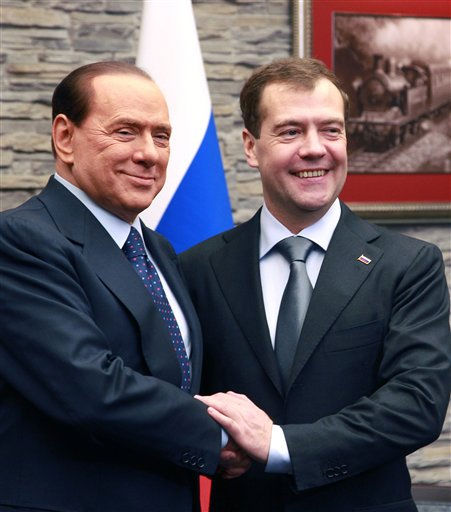 "<div class=""meta ""><span class=""caption-text "">Russian President Dmitry Medvedev, right, welcomes Italian Prime Minister Silvio Berlusconi at the Russian Black sea resort of Sochi on Friday,  Dec. 3, 2010. Italy's prime minister is on an official visit to Russia against the background of a leaked U.S. diplomatic cable that alleges an uncomfortably close relationship between him Russian premier Vladimir Putin. (AP Photo/ Vladimir Rodionov)</span></div>"