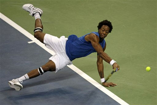 "<div class=""meta ""><span class=""caption-text "">Gael Monfils of France returns the ball to Janko Tipsarevic of Serbia during their Davis Cup final tennis match in Belgrade, Serbia, Friday, Dec. 3, 2010.(AP Photo/ Marko Drobnjakovic) (AP Photo/ Marko Drobnjakovic)</span></div>"