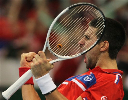 "<div class=""meta ""><span class=""caption-text "">Novak Djokovic of Serbia celebrates after their Davis Cup Final match against Gael Monfils of France, in Belgrade, Serbia, Sunday, Dec.5, 2010. Djokovic won 6-2, 6-2, 6-4 to make it all square in the best-of-five series. (AP Photo/Darko Vojinovic) (AP Photo/ Darko Vojinovic)</span></div>"