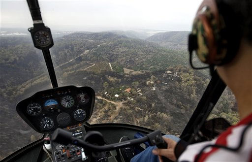 A burnt forest is seen from a helicopter, after a massive wildfire in the Carmel, northern Israel, Tuesday, Dec. 7, 2010. The fire broke out Thursday and burned a 20-square-mile &#40;50-square-kilometer&#41; area in the Carmel forest, a popular nature spot on Haifa&#39;s outskirts. The blaze was brought under control late Sunday and damages overall have been estimated in the hundreds of millions of dollars. Although the wildfire was small by international standards, it was considered a calamity in Israel, where only 7 percent of the land is wooded. &#40;AP Photo&#47;Sebastian Scheiner&#41; <span class=meta>(AP Photo&#47; Sebastian Scheiner)</span>