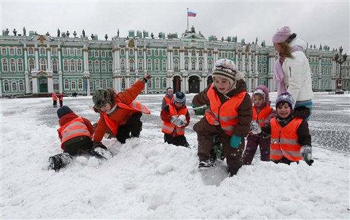 Children from a kindergarden group wearing safety vests, play in snow at Dvortsovaya &#40;Palace&#41; Square in St.Petersburg, Russia, Tuesday, Dec. 7, 2010,  in front of the Zimny &#40;Winter&#41; Palace. The temperature in St.Petersburg is around -3 C &#40;27 F&#41; &#40;AP Photo&#47;Dmitry Lovetsky&#41; <span class=meta>(AP Photo&#47; Dmitry Lovetsky)</span>