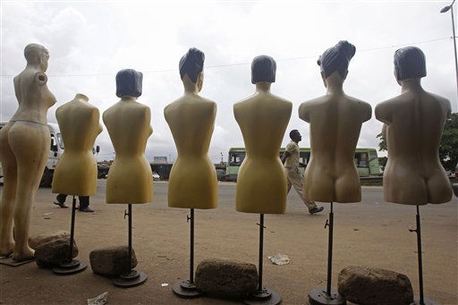 A man walks past manikins on display at a local market in the city of Abidjan, Ivory Coast, Tuesday, Dec. 7, 2010. Hundreds of residents have fled Ivory Coast, United Nations officials said Tuesday, as the U.N. also began evacuating some 500 staffers after a contentious election that has resulted in both candidates claiming the presidency. &#40;AP Photo&#47;Schalk van Zuydam&#41; <span class=meta>(AP Photo&#47; Schalk van Zuydam)</span>