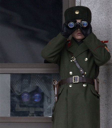 A North Korean soldier looks at the southern side through telescopes at the border village of the Panmunjom, South Korea, Wednesday,  Dec. 8, 2010. The top military leaders from the United States and South Korea were holding talks on the Korean peninsula&#39;s security worries on Wednesday, as North Korea was apparently holding its regular firing exercises.&#40;AP Photo&#47;Ahn Young-joon&#41; <span class=meta>(AP Photo&#47; Ahn Yioung-joon)</span>