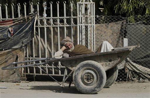 "<div class=""meta ""><span class=""caption-text "">An Afghan porter takes a nap in his push cart as he waits to be hired in Kandahar, Afghanistan Wednesday, Dec 8, 2010. (AP Photo/Allauddin Khan) (AP Photo/ Allauddin Khan)</span></div>"