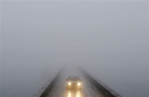 "<div class=""meta ""><span class=""caption-text "">A car in fog crosses a bridge over a canal, near the city of Niksic, Montenegro, Wednesday, Dec. 8, 2010. People across Albania, Bosnia, Serbia and Montenegro have struggled with a torrent of floods experts have called the worst in a century. Authorities in Serbia and Montenegro had to evacuate thousands of people from flooded villages. (AP Photo/Risto Bozovic) (AP Photo/ Risto Bozovic)</span></div>"